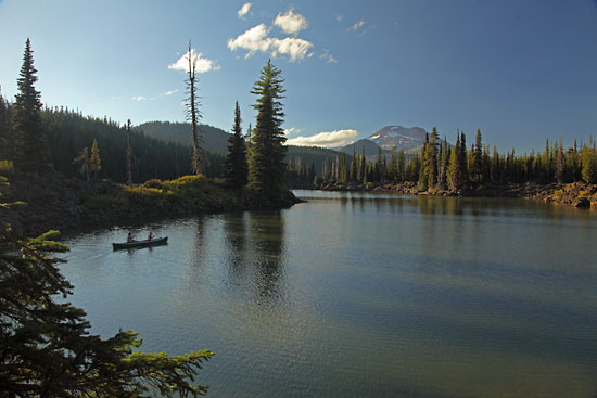 Canoeing in the Cascade Mountains Sparks Lake Canoe, S. Sister, near Bend, Oregon