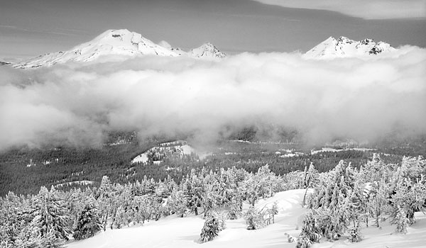 Cascade Volcanoes rise above low clouds, South Sister and Broken Top from Mt. Bachelor, Cascade Mountains, Oregon Photograph by David Whitten